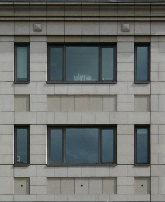 Stone building facade with black window frames - Buildings - Urban ...
